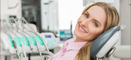 Smiling woman in dental crown